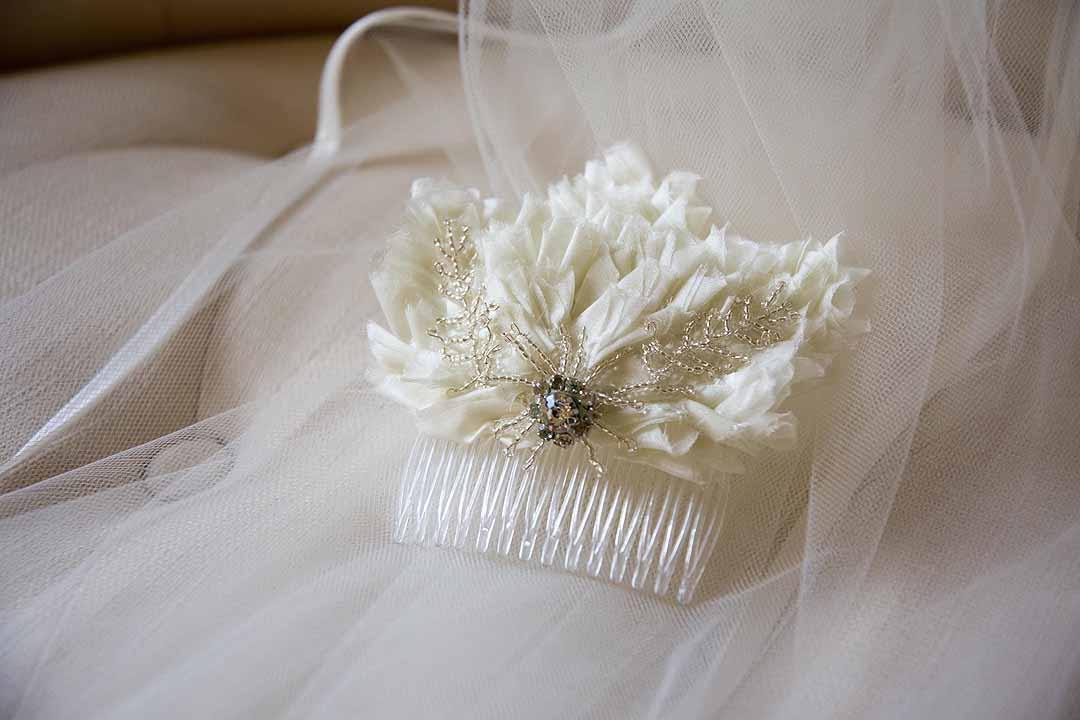 white feather hair slide with sparkle