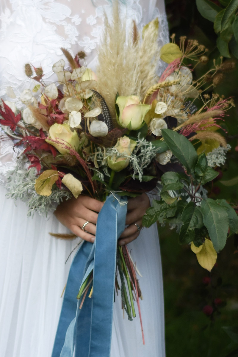 autumn wedding bouquet with roses and dried flowers