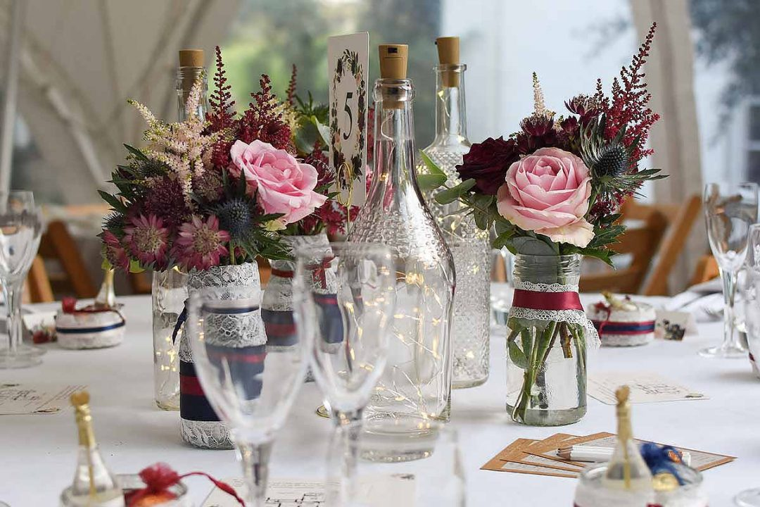 up-cycled wine bottles and jam jars