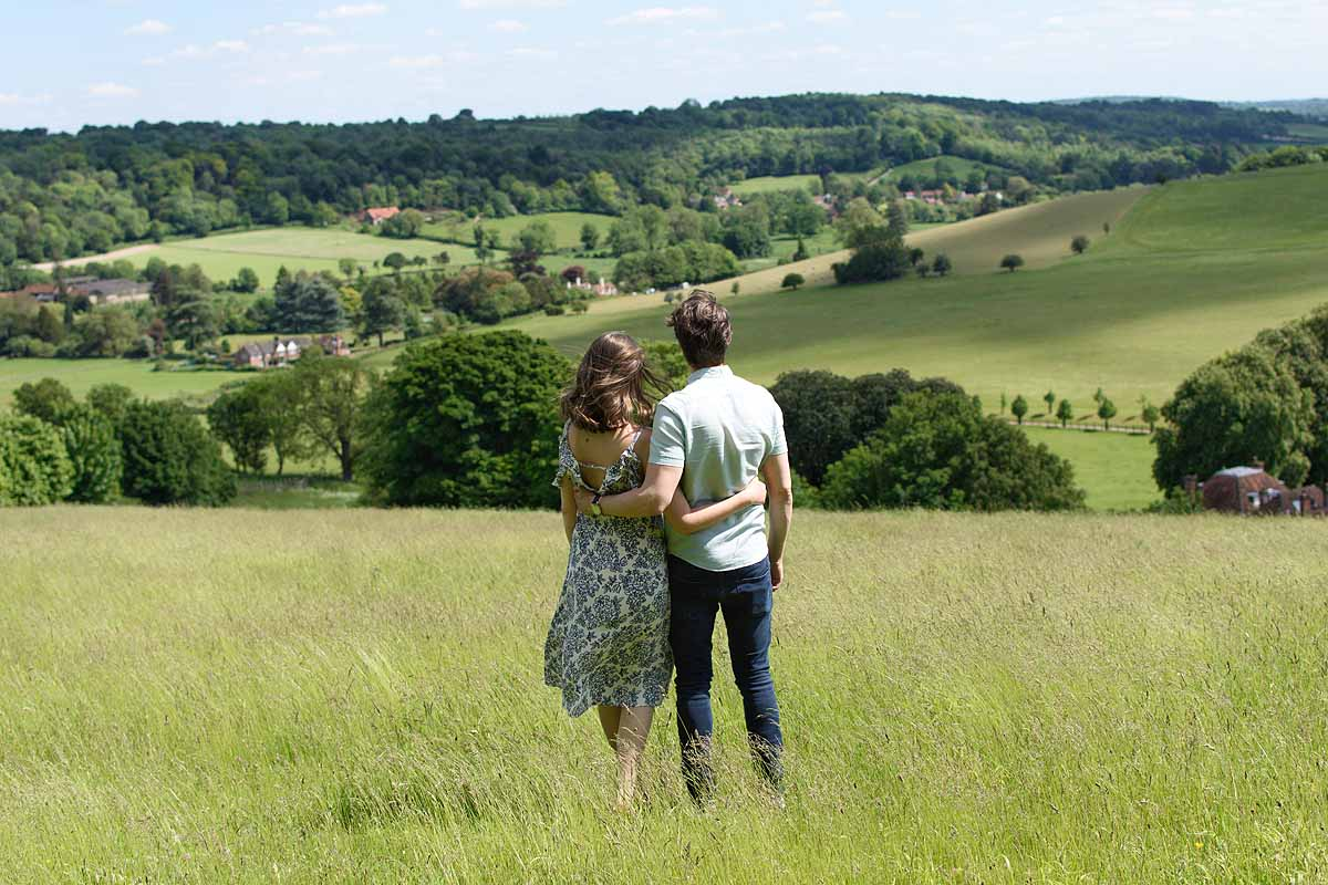 couple looking out at view across hills